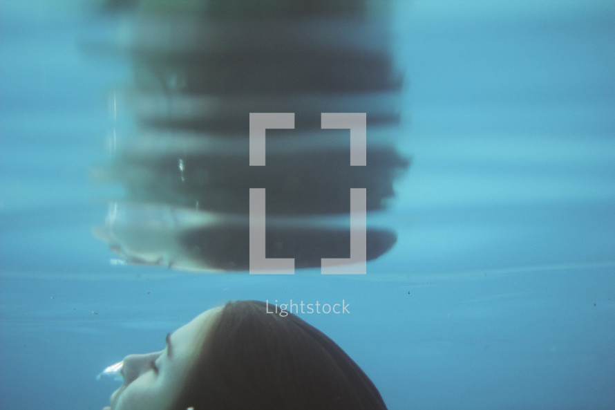 a woman under water