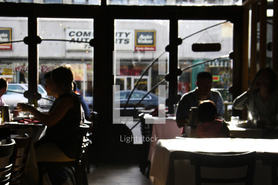 silhouettes of people at a coffee shop