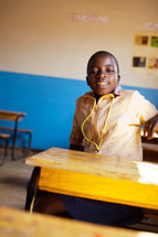 A child in a classroom in Malawi, Africa