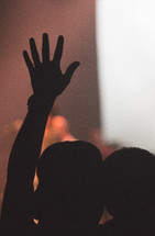 silhouette of a man holding a boy at a concert