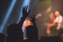 silhouettes of a father and son at a concert