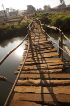 A modest walking bridge over a river in Malawi, Africa.