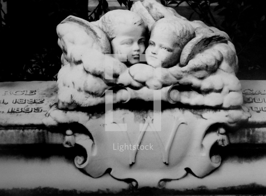 Cherub angel children grave marker on a historic grave site of a child that passed away in 1895.