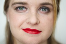 face of a woman wearing red lipstick