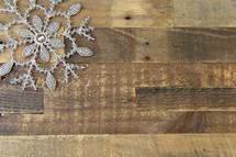 snowflake in a corner on a wood floor background