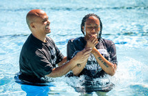 adult baptism dunking in water