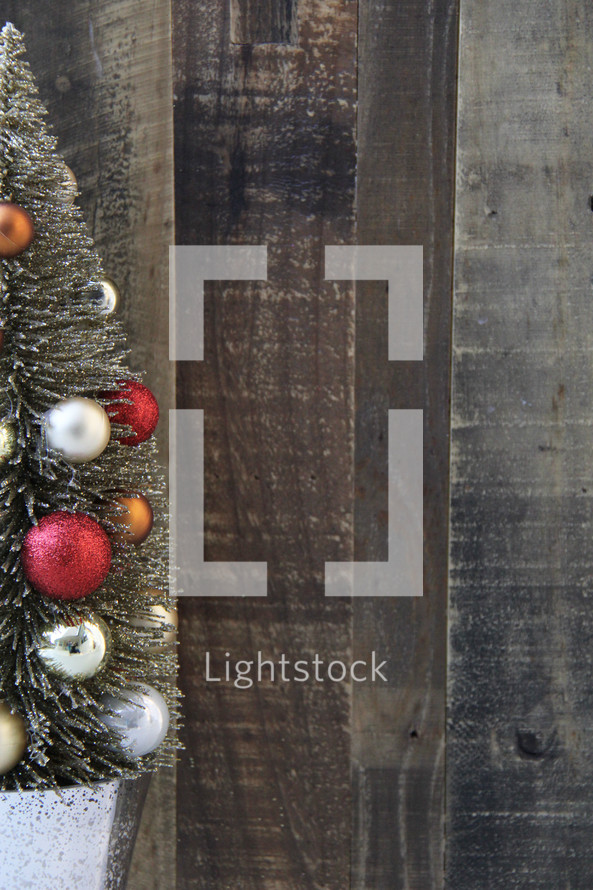 Christmas tree border against a wood floor background