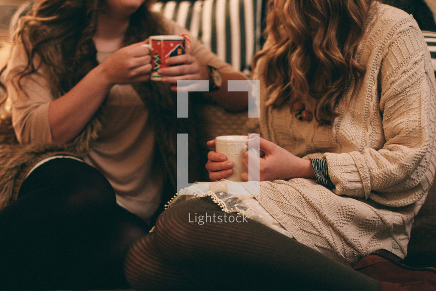 women in conversation drinking hot cocoa