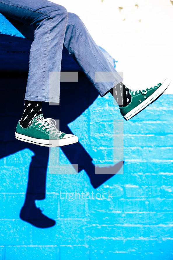 dangling feet with sneakers