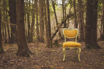 yellow chair in a forest