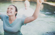 Joyous woman giving praise after being baptized.
