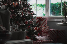 gifts by a Christmas tree