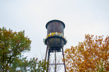 rural water tower and fall trees