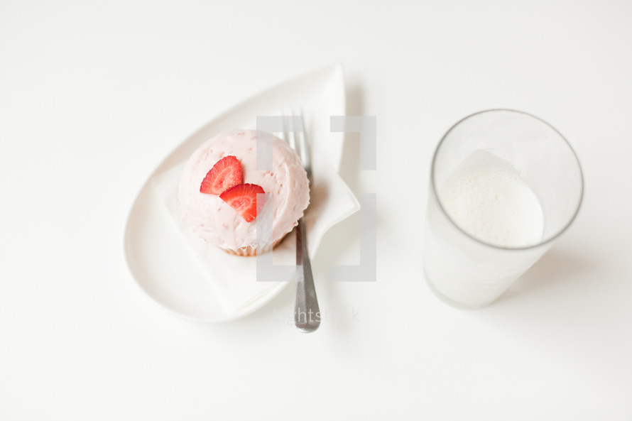 strawberry cupcake on a plate
