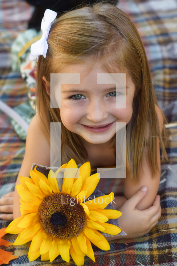 toddler girl with a sunflower