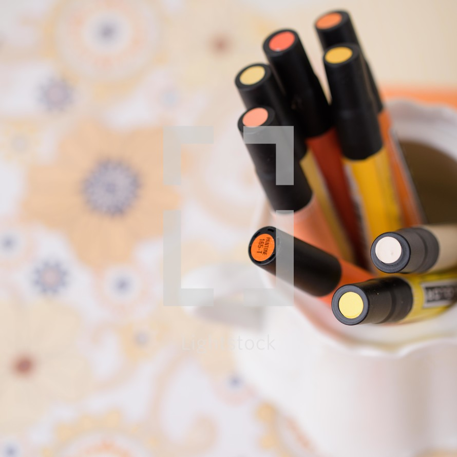 scrapbooking paper and orange and yellow paint pens