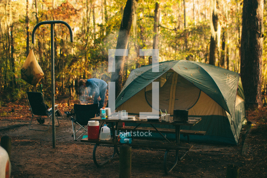 tent and picnic table in a camp grounds