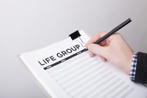 A man signing up to in a life group