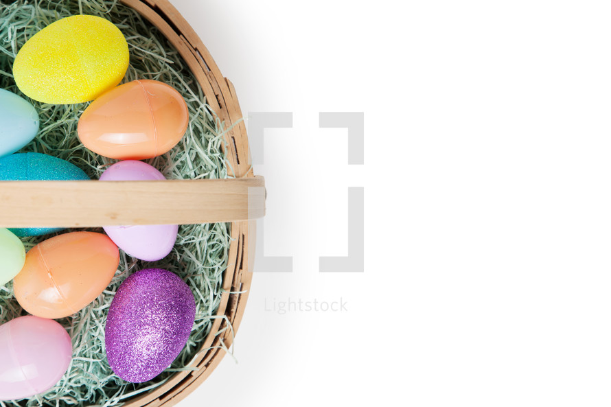 Easter eggs in a basket from an above angle.