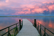lake dock and pink clouds