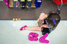 girl child trying on shoes