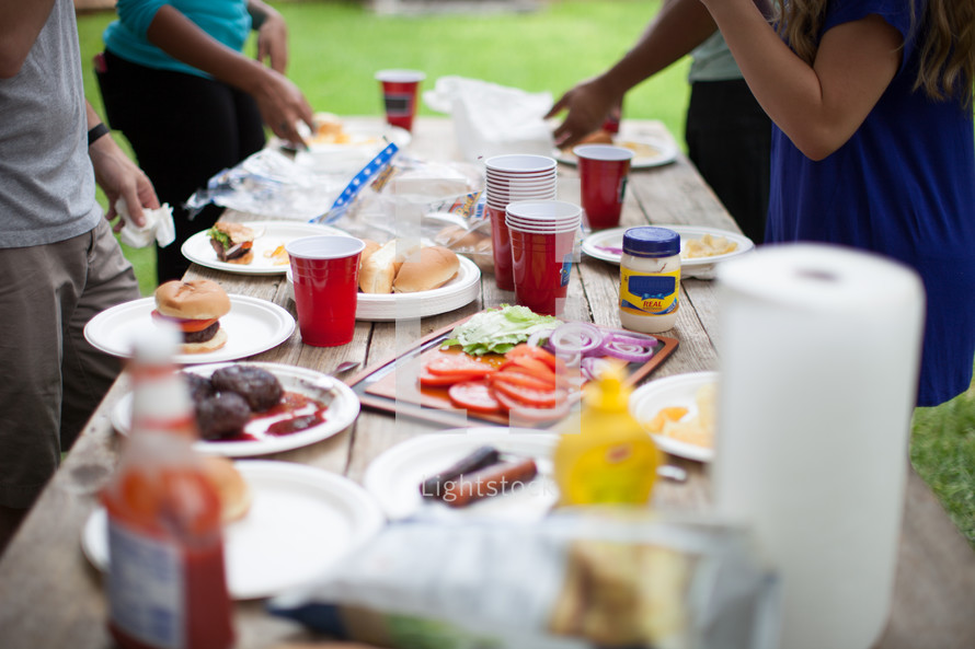 food on a picnic table at an outdoor cookout
