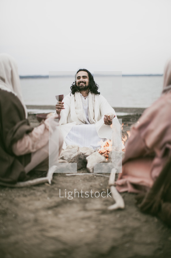 Jesus offering communion to his disciples