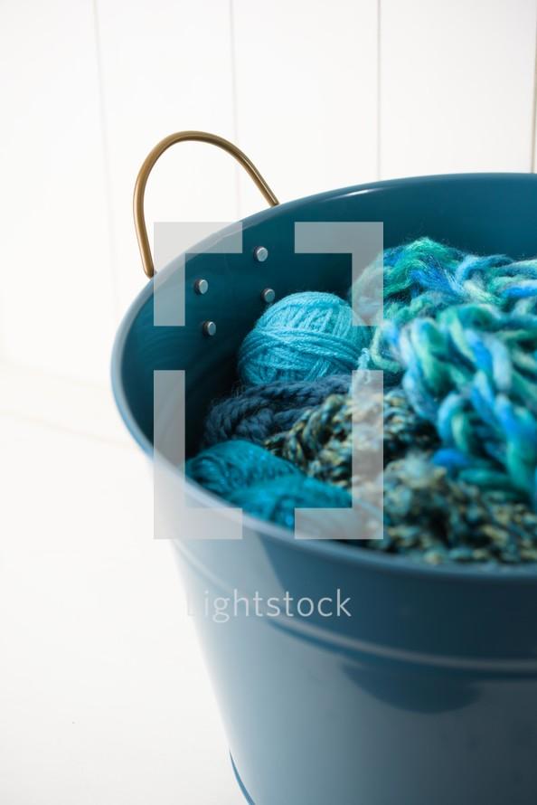 bucket of turquoise yarn
