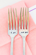 Two engraved forks on pink napkin I do me too wedding