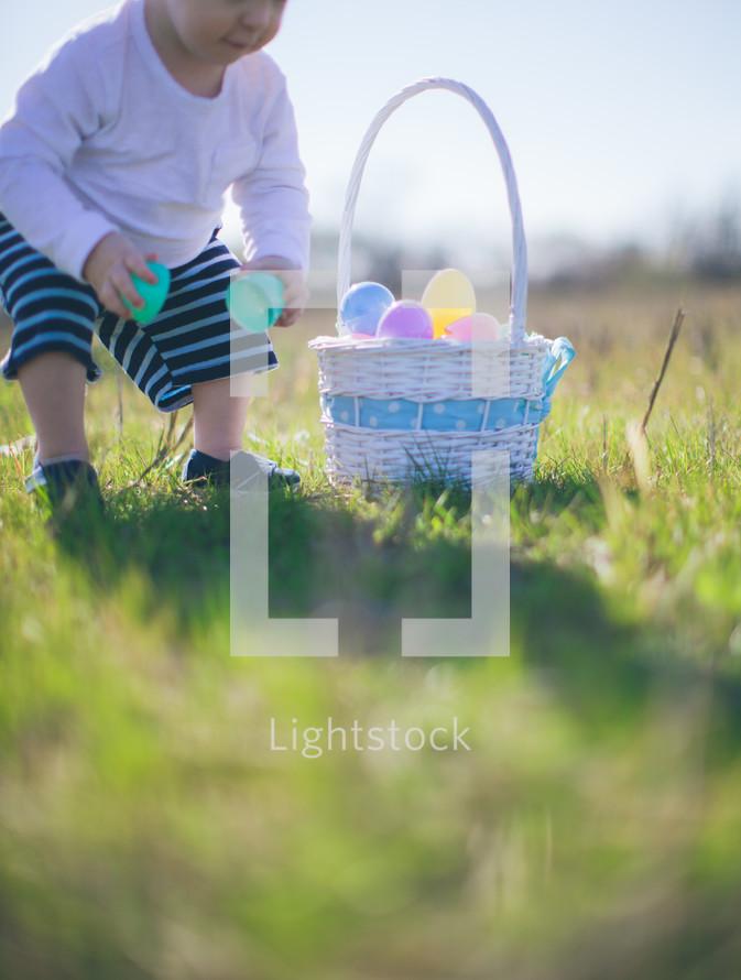 toddler on a Easter egg hunt