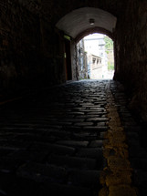 tunnel on a cobble stone street