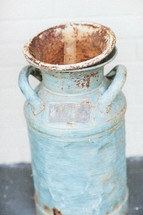 rusty milk jug