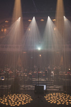 lights shining over an empty stage