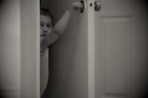 a toddler opening a door