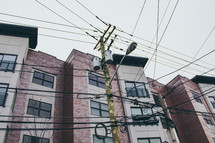 power lines on power poles and apartments