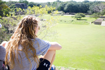 woman looking out at the landscape in front of her