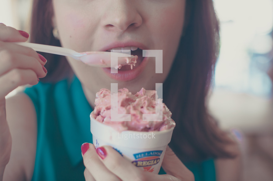 woman eating a cup of ice cream