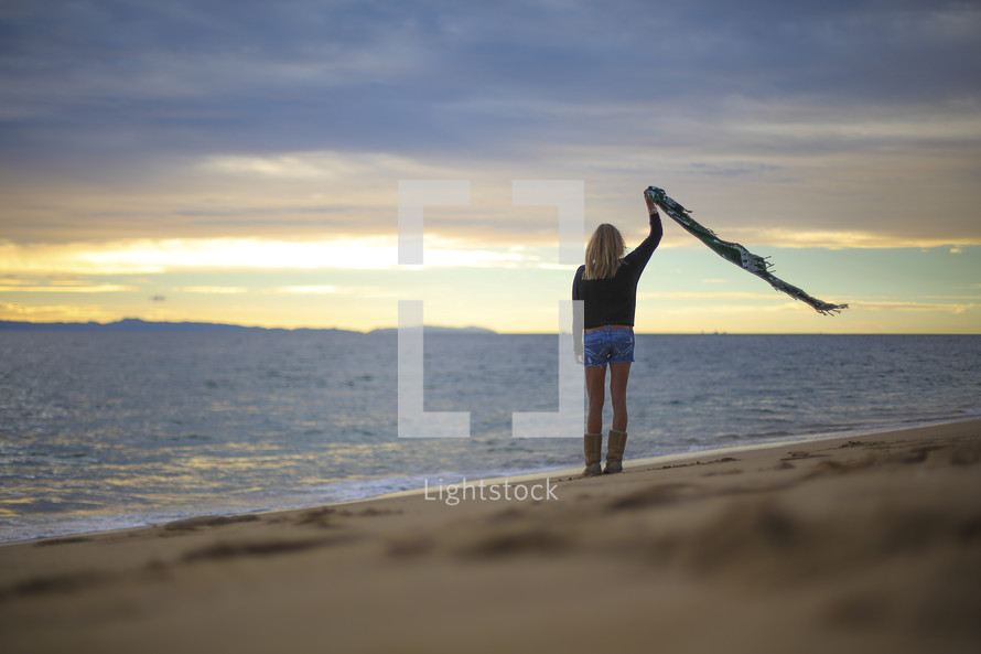 woman standing on a beach
