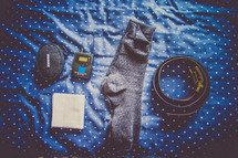 socks, handkerchief, belt, sound equipment on a bed