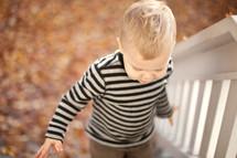 toddler boy walking up stairs