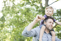 toddler on his father's shoulders