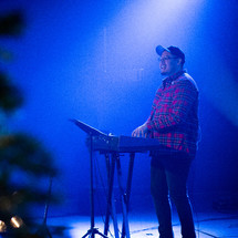 man playing a keyboard on stage