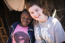woman missionary and child hugging