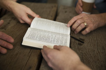men's group with a Bible