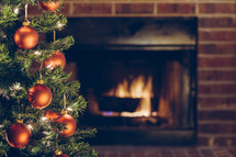 Christmas tree in front of a hearth