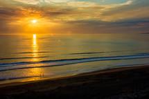 golden rays of sunlight over the ocean