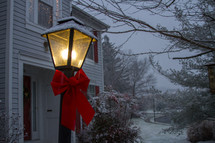 street lamp with a red bow