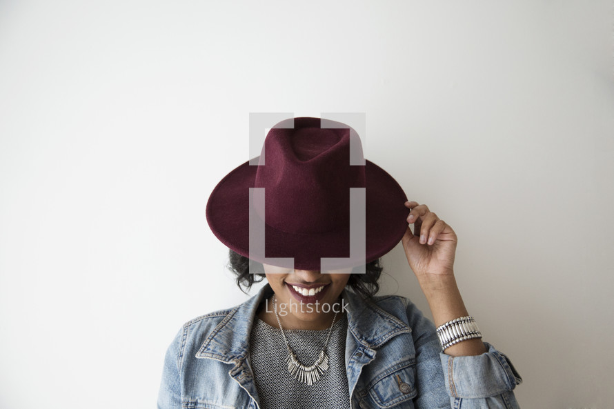 An African American woman wearing a hat