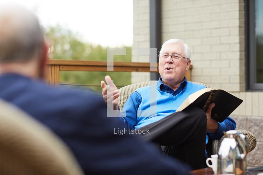 Man talking in older men's Bible study