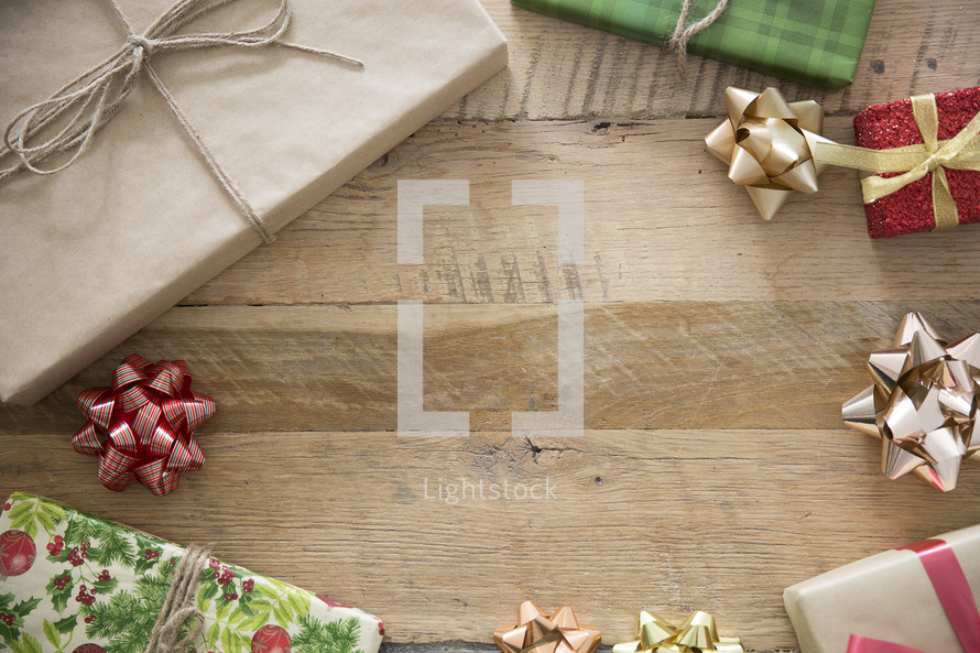 border of Christmas presents on wood
